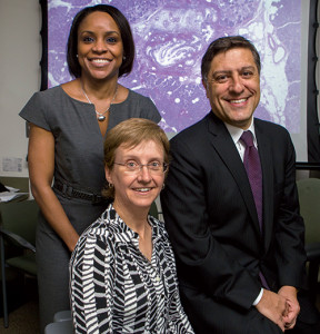 "Lead author Dr. Volkan Adsay (right), with coauthors and Emory pathologists Alyssa Krasinskas, MD (front), and Michelle Reid, MD. The new guideline fills a gap in IPMN pathologic evaluation and reporting, says Dr. Adsay. ""A lot of pathologists are being exposed to this entity."""