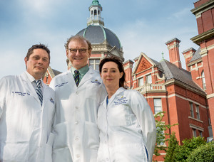 "Dr. Anne Marie Lennon (above), who oversees the Multidisciplinary Pancreatic Cyst Clinic at Johns Hopkins, says colleagues such as Dr. Ralph Hruban (center) and Dr. Christopher Wolfgang (left) ""bring huge depths of knowledge"" to patient management discussions each week. ""We all learn from each other."""
