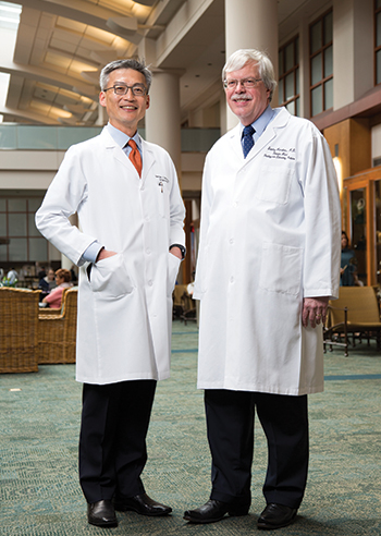 "Dr. Stan Hamilton (right) at the University of Texas MD Anderson Cancer Center with George Chang, MD, MS, a professor in the Department of Surgical Oncology and chief of the section of colon and rectal surgery. The guideline on molecular biomarkers for the evaluation of colorectal cancer ""has brought the quality control aspect [of testing] front and center,"" says Dr. Hamilton."