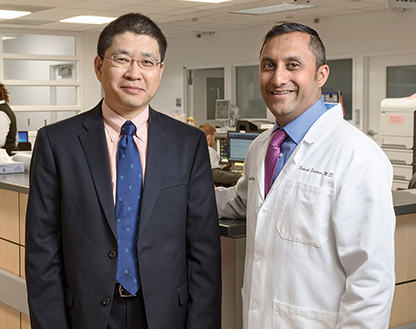 "The Cleveland Clinic went live with Roche's TnT Gen 5 Stat assay in June. ""The only way to make a smooth transition is to have a team composed of all the stakeholders,"" says Dr. Sihe Wang (left), here with emergency medicine physician Rakesh Engineer, MD."