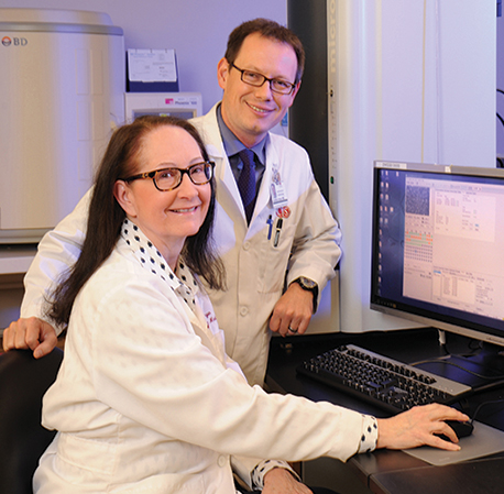 Dr. Margie Morgan with Jonathan Grein, MD, infectious disease specialist and associate director of hospital epidemiology at Cedars-Sinai. With its MALDI-TOF, the microbiology lab has seen an 18-hour decrease in the time for reporting identification of enteric Gram-negative rods.