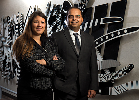 """Henry Ford Health System's Dr. Gaurav Sharma (right) and Jacqueline Copeland use analytics to track, trend, and prevent preanalytic defects. """"We're trying to gather and look at large amounts of data with the aim of converting it into information that leads to action,"""" Dr. Sharma says."""