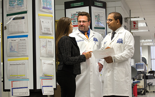 Dr. Sharma and Copeland, of the Henry Ford Health System, have worked with clinical microbiology associate director Robert Tibbetts, PhD (center),  on many laboratory analytics projects, including the evaluation of MALDI-TOF's downstream impact on lengths of stay and patient costs.