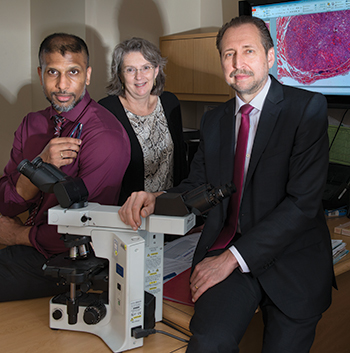 """""""Way overdue"""" is how many see the nomenclature revision for noninvasive encapsulated follicular variant of papillary thyroid carcinoma, says Dr. Yuri Nikiforov (right), with Dr. Sally Carty and Dr. Raja Seethala at UPMC."""
