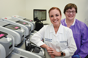 A yearly algorithm, a triage system, and a dashboard keep molecular testing for respiratory pathogens on track at Geisinger. Random-access testing and a reduced TAT are saving the health system millions, says Dr. Martinez (left), here with Barb Heiter, BS, MT(ASCP).