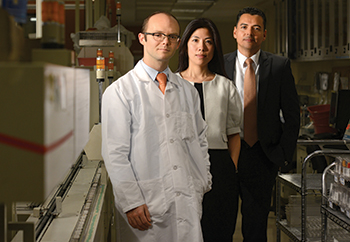 Dr. Joshua Hayden (left) at New  York-Presbyterian Hospital with  Su-Chieh Pamela Sun, MPA, MT(ASCP), central lab program manager, and Juan Garcia, MBA, BSMT, central lab program director. With procalcitonin on the Roche platform, Dr. Hayden foresees expanded use and lower prices, and he hopes to someday see an approved indication for PCT in guiding antibiotic use.