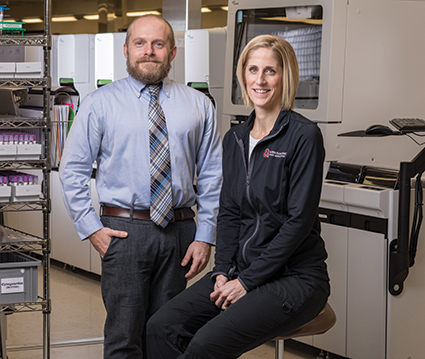 """Dr. Steven Cotten with point-of-care coordinator Sara Enders, MT(ASCP), at Ohio State University Wexner Medical Center. They and others rolled out a program two years ago, called BRAVE, that defines criteria for when a capillary specimen is appropriate. """"We consider the criteria clinical decision support related to proper device use,"""" Dr. Cotten says."""